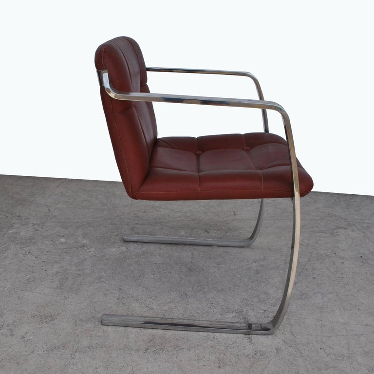 Cumberland Furniture Corp  Two vintage Cumberland stainless steel and leather armchairs.    Measures: Seat height 17
