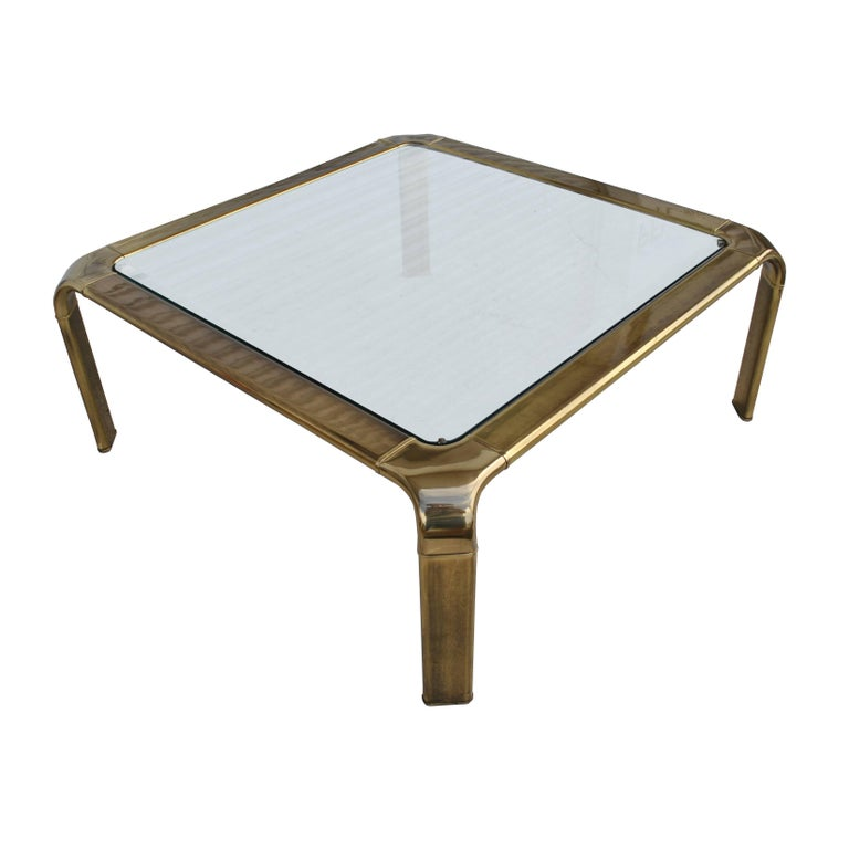 Widdicomb   Vintage midcentury waterfall brass coffee table byWiddicomb   1970s    A waterfall style brass plated frame with a thick beveled glass insert.