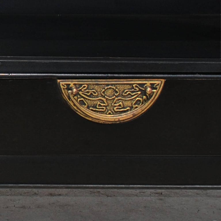 A pair of Asian inspired nightstands by Century Furniture.  Ebonized with brass pulls on drawer at bottom. Ample open area above for storage and books.