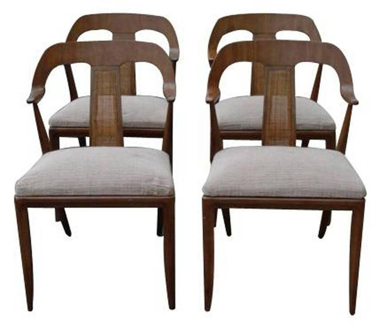 Set of four Danish style side chairs   Walnut frame, original caning in back panel  Vintage multi-colored fabric, original finish, very good vintage condition.  This is for a set of 4 chairs.