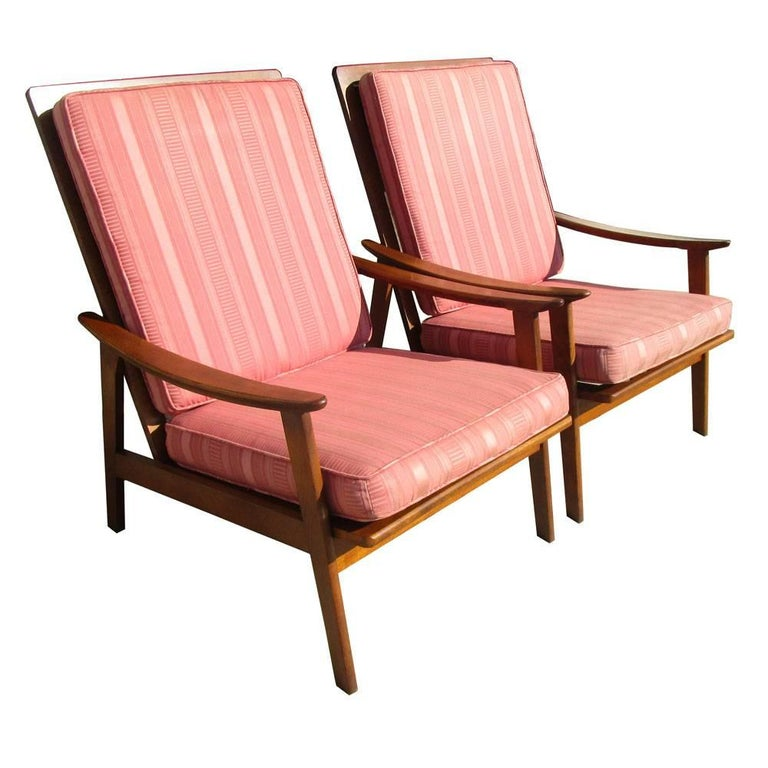 Vintage midcentury pair of Danish lounge chairs Walnut frame with striped upholstery Reupholstery recommended.