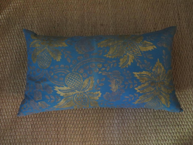 Extravagant pillow featuring hand-dyed linen that has been created using illustrated wooden blocks, which in turn have been carved and painted entirely by hand. The designs come crashing through every piece with old world and modern charm, while