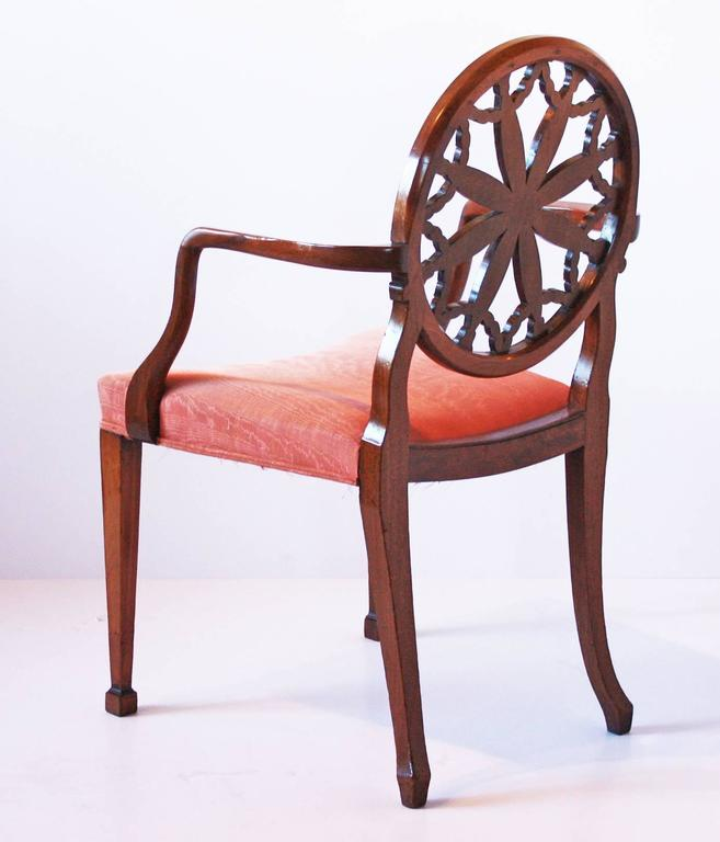 Carved Pair of George III Mahogany Elbow Chairs in the Manner of Robert Adam For Sale