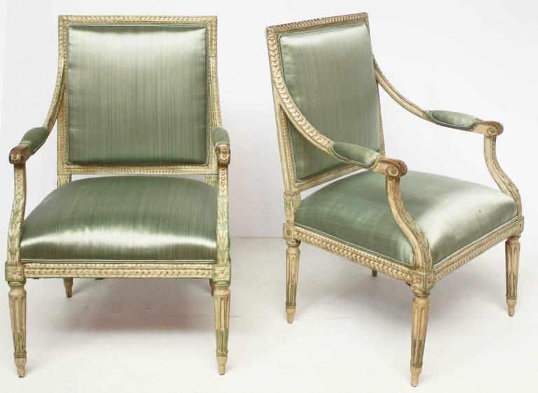 A group of four carved and painted open-armchairs / fauteuils, Louis XVI / neoclassical, circa 1790, with mint green-blue silk upholstery.Possibly Swedish  $5,850.00 per pair. Will sell as pairs.