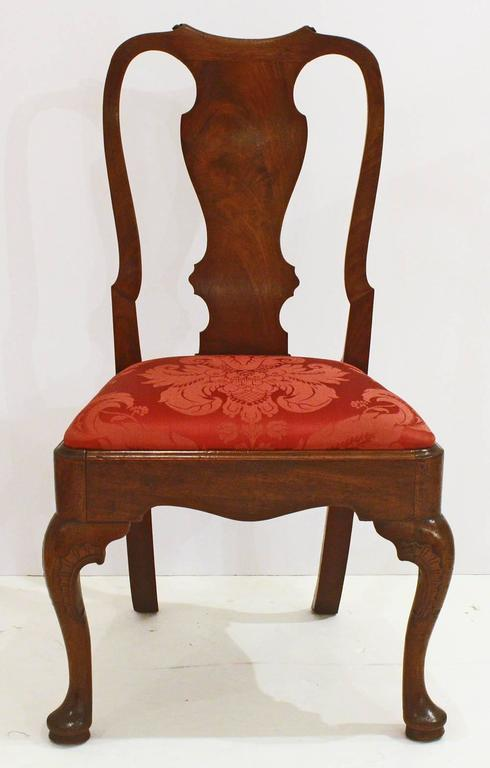 Set of five late George II or early George III mahogany side chairs with slip seats upholstered in crimson silk damask, shaped crest rail and stiles, vasiform splat, splayed rear legs and shaped cabriole front legs with pad feet.
