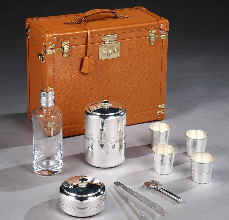 An extremely rare, special-order travelling bar by Louis Vuitton, circa 1980s. In effectively unused condition, the square case with top carrying-handle is in gold Epi leather, with gold-plated studs, latches and lock and original key.   The