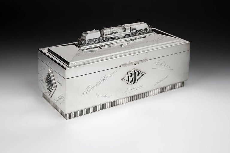A massive and extremely impressive, Sterling silver cigar box made by the well-respected Sheffield firm of Silversmiths Walker & Hall, and commissioned as a presentation piece in 1948 and gifted to leading Welsh industrialist Hugh Vivian