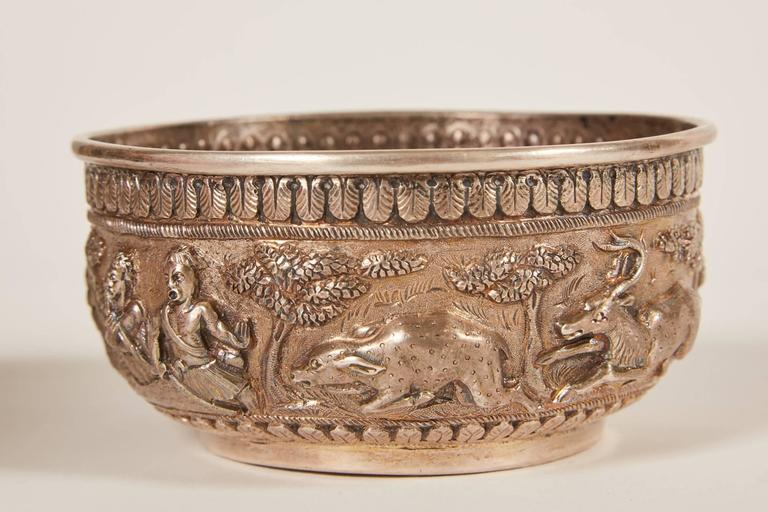 A stunning small 20th century Indian silver bowl in the Anglo-Raj style. The bowl is comprised of mythical creatures, foliage and Classic Indian motif relief.