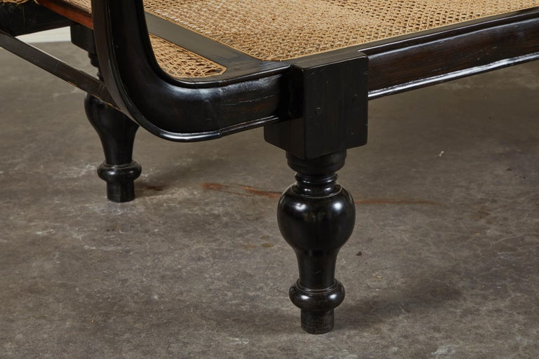 Anglo-Indian 20th Century British Colonial Ebony Bench with Caned Seat and Arms For Sale