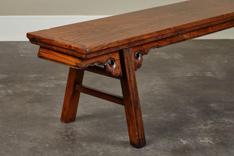 A long and simple Chinese elm bench, circa 18th century.