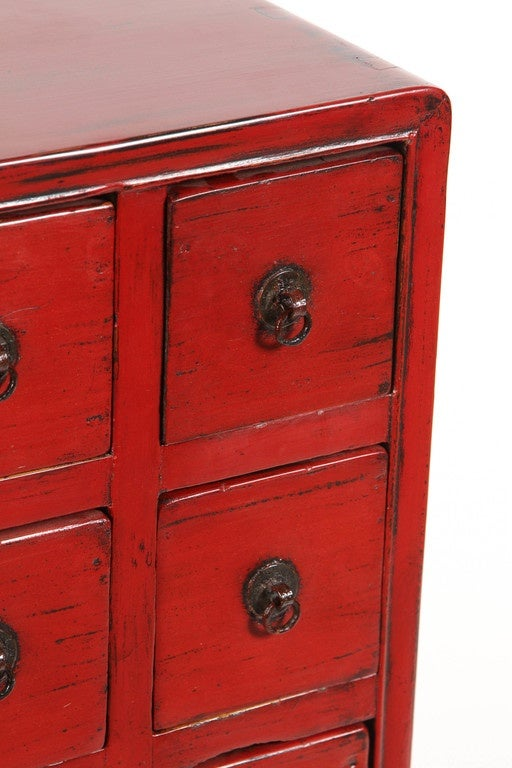 A 19th Century Chinese Red Medicine Chest, With Five Rows Of Three Drawers  That Have