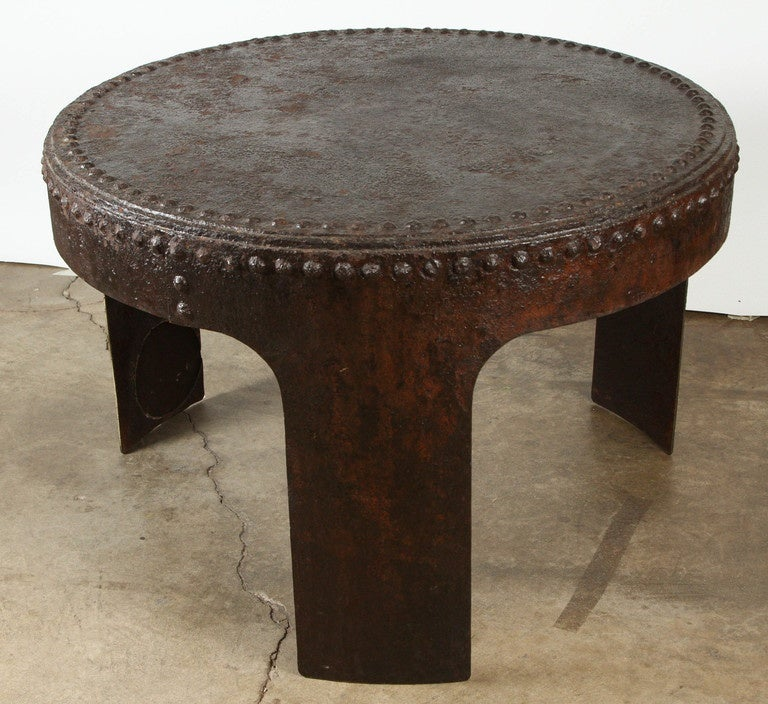 this industrial salvage round iron table is no longer available