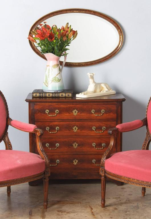 A Louis Philippe chest of drawers from the Provence region made of mahogany veneer. The commode rests on bracket feet, the four drawers have shaped brass drop handles and key escutcheons.