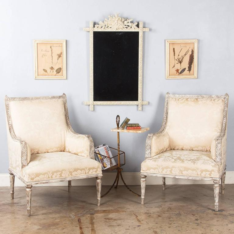 A set of six French pressed botanicals in wooden frames painted in gold and ivory tones. The botanicals are from a private collection and can be dated from the 1930s.