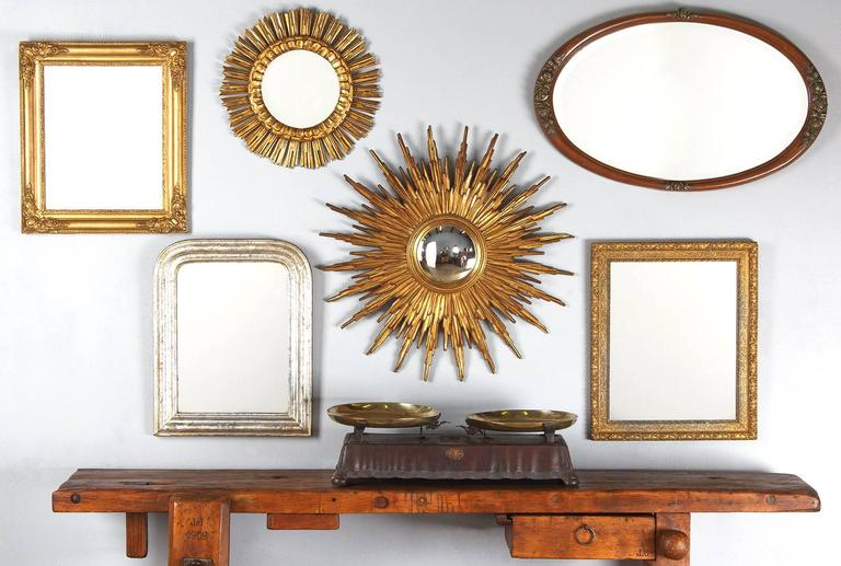 A Napoleon III period small rectangular mirror in a carved gilded wood and plaster frame. The mirrored glass is original.