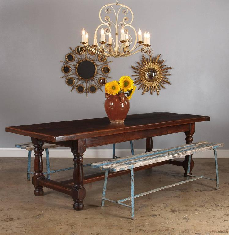 A marvelous French oak farm table with heavy baluster legs, circa 1870s. The top consists of two great oak slabs joined at the center and capped on either end with a matching piece of oak. In typical French fashion, the table is long and narrow.