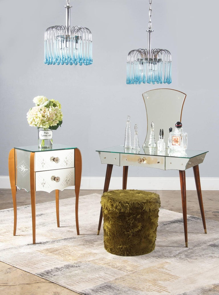 A chic Mid-Century Venetian mirrored glass vanity table, circa 1950s. This table boasts confident angles and strong lines. Scalloped bevel cut edges trim the glass, which has a scalloped front profile and set back, angled sides, along with a stylish