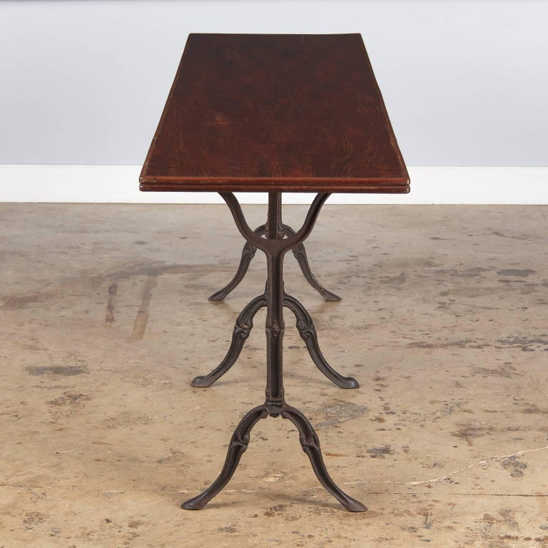 Industrial French Iron Base Bistro Table with Lacquered Wooden Top, 1920s For Sale