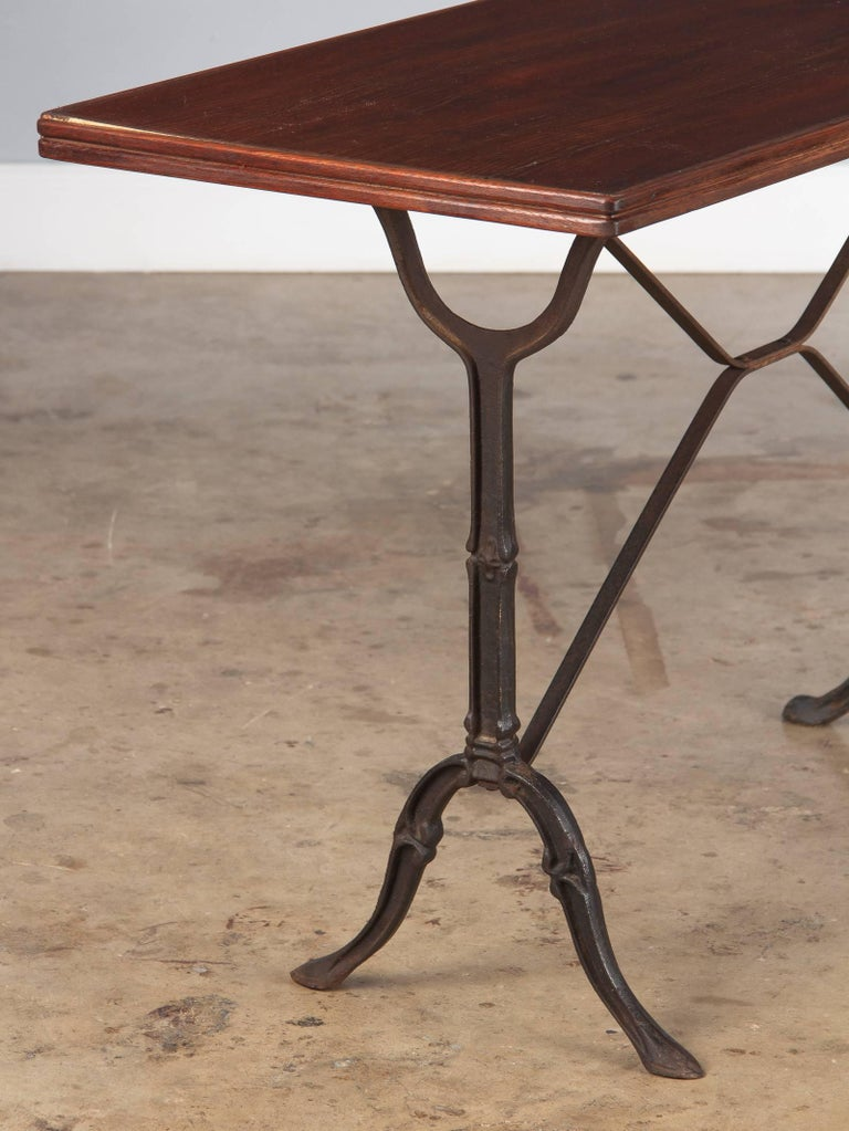 Wrought Iron French Iron Base Bistro Table with Lacquered Wooden Top, 1920s For Sale
