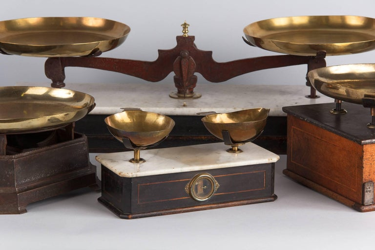 A petite marble top Napoleon lll herbalist scale, French, circa 1870. This lovely little scale was used to measure herbs and tobacco. The white marble top has gray veining and bull nose edges with beveled corners. Ebonized wood base with thin inlaid