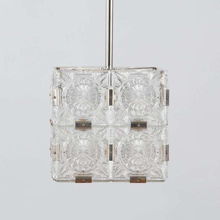 Modern Set of Three Cut-Glass and Chrome Pendants, France, 1970s For Sale
