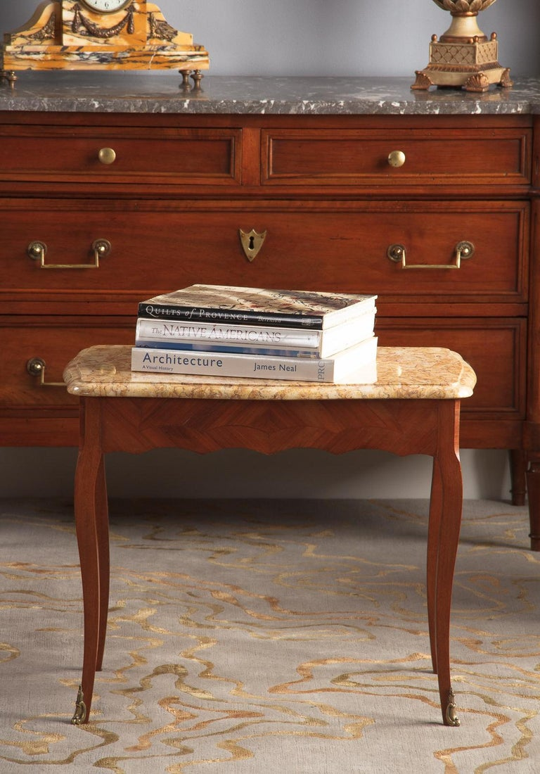 An attractive vintage Louis XV style side table with Breche marble top, French, circa 1940. Lightly scalloped Breche marble in creams, blushes and light browns with molded edge. Scalloped aprons around the base with contrasting banded blonde