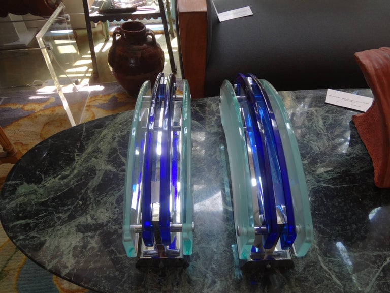Great pair of Italian Mid-Century Modern Murano glass sconces By Veca comprised of two sheets of frosted beveled glass on the exterior and two sheets of cobalt blue beveled glass in the center. Chrome structures that have been newly wired for the