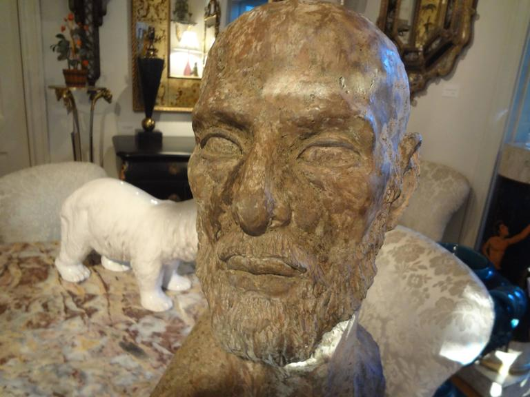 Handsome Italian Greco Roman terra cotta bust mounted on a steel base, circa 1940s.