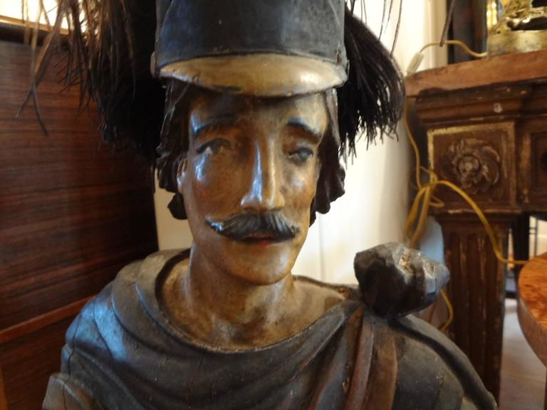18th century carved and painted wood Spanish conquistador figure or sculpture. This beautifully carved antique Spanish figural sculpture measures 35 inches in height.