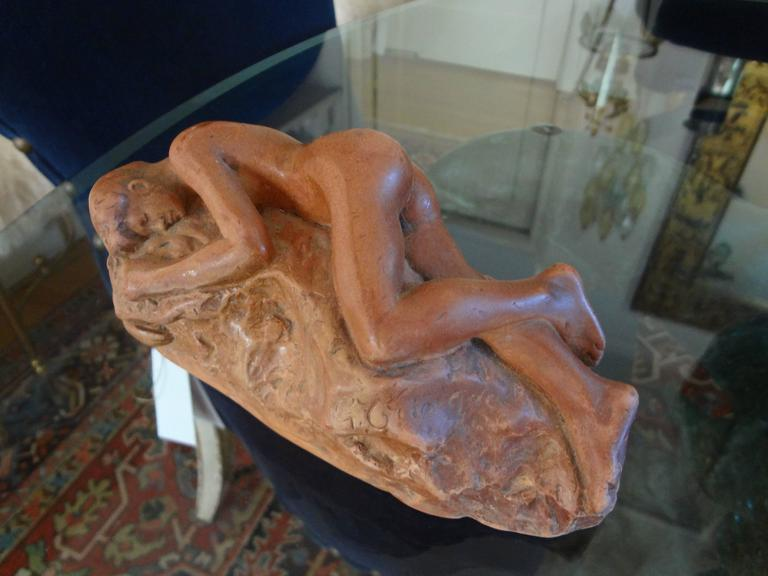 Beautifully executed French terracotta nude sculpture from the 1920s. This French figurative sculpture is signed but unfortunately the signature is illegible (See photos).