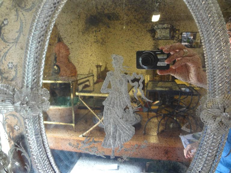 Lovely Italian Venetian glass mirror with a Neoclassical etched figure in the center. No cracks, only naturally occurring foxing.