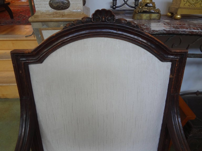 Stunning large pair of antique Italian walnut armchairs or fauteuils from Tuscany taken down to frame and professionally upholstered in striated white velvet. Finely carved, great proportions, beautiful patina, comfortable and will accommodate a