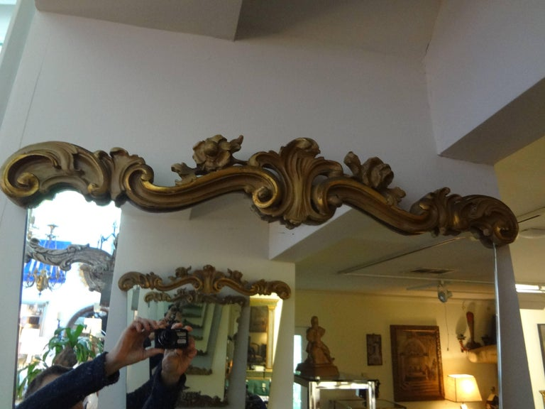 Stunning pair of Italian Serge Roche or Dorothy Draper inspired painted and gilt wood mirrors, circa 1940s. These fabulous mirrors would look great above consoles, credenzas, commodes, chests or buffets.
