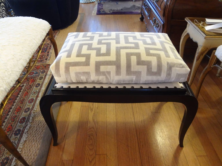 Period French Art Deco bench, stool or ottoman with black lacquered finish professionally upholstered in Greek key cut velvet fabric, circa 1930. This French Art Deco Dominique inspired bench would work well in a black and white interior.