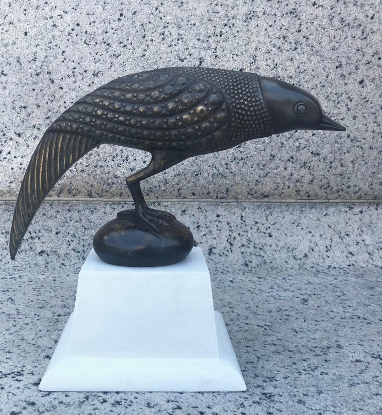 Fabulous 1970s French bronze bird sculpture in the style of Armand Rateau. Mounted on a shaped plaster finish stand. Incredible detail and presence.