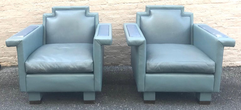 Exceptional pair of blue-gray custom-made leather lounge chairs designed by Ronn Jaffe, circa 1985. These have a wonderful Postmodern, slightly Memphis vibe to them, with unparalleled craftsmanship and quality. They're also extremely comfortable!