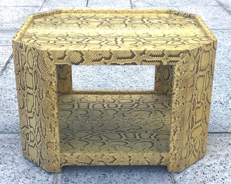 Exceptional and rare 1970s cocktail table or side table completely covered in natural python skin by noted master designer Karl Springer. The quality and craftsmanship are absolutely unparalleled on this piece, with the hides meticulously laid down