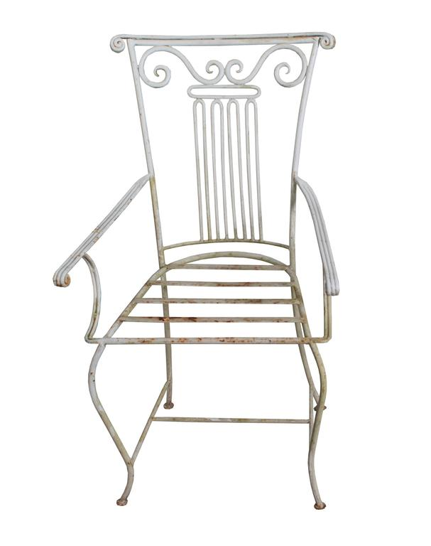 Set of six Neoclassical Wrought Iron Garden Chairs.  Arm Height 25 inches.