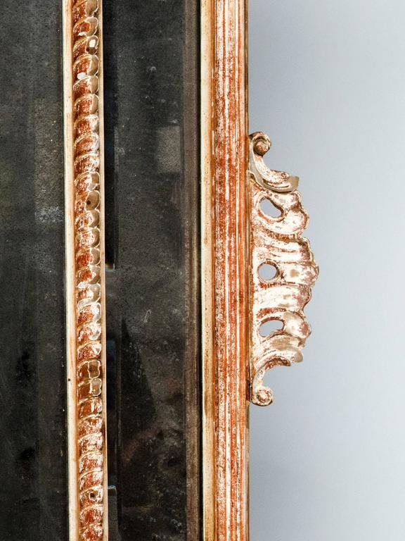 A very nice large carved wood mirror, mirror itself is very frosted. Superb carved shell to the top, very decorative. Gold leaf in parts has wear.