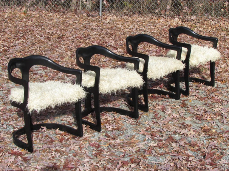 Set of four black enameled chairs with rounded backs with flokati upholstered seats by Broyhill.