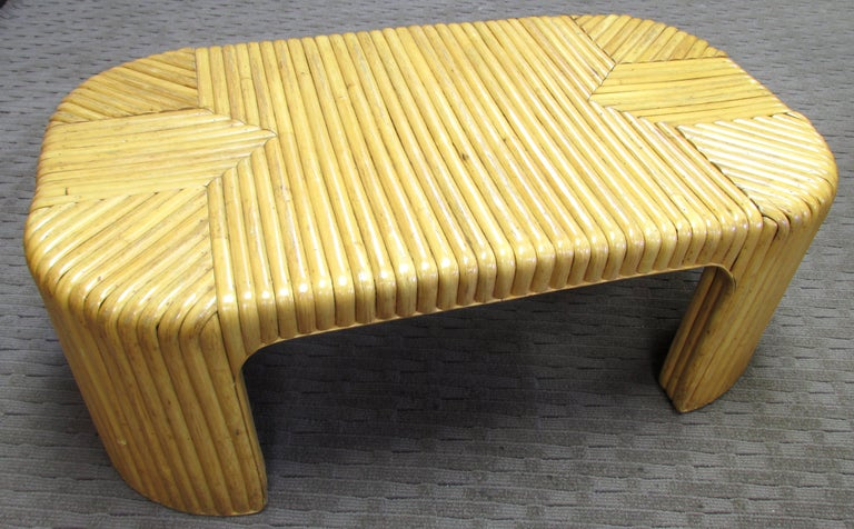 Nice oblong coffee table covered with rattan in graphic pattern with rounded corners