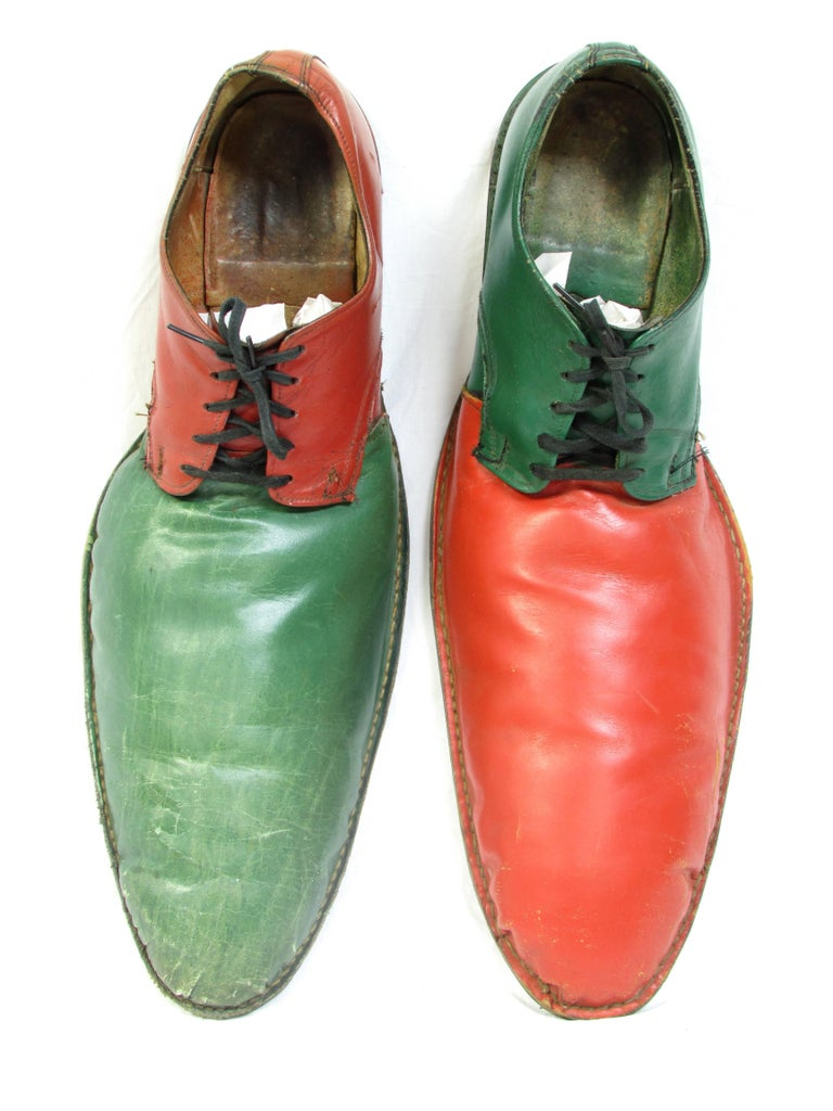 Pair of vintage handmade leather clown shoes dyed and painted alternating colors of orange and green size 8-9