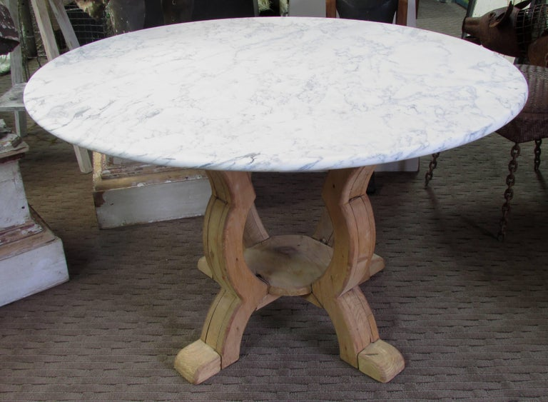 Stripped and weathered pine base table with a round marble top