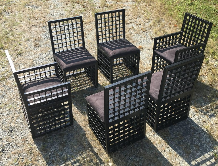 "Set of black painted wooden chairs made with ""grid"" pattern with two armchairs and four side chairs by Cy Mann."