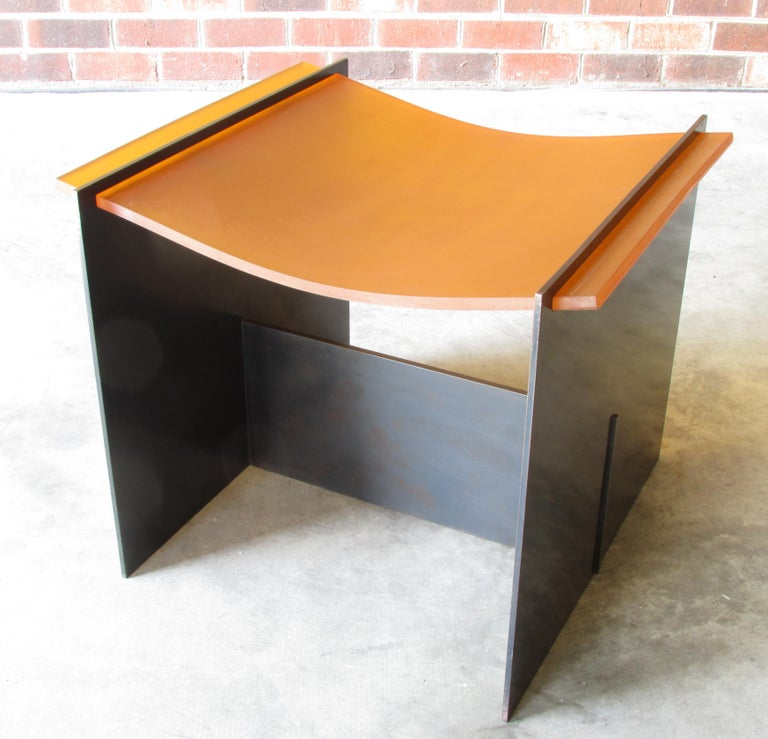Minimalist simple style stool or seat made of blackened steel and suspended rubber seat by David Gulasso.