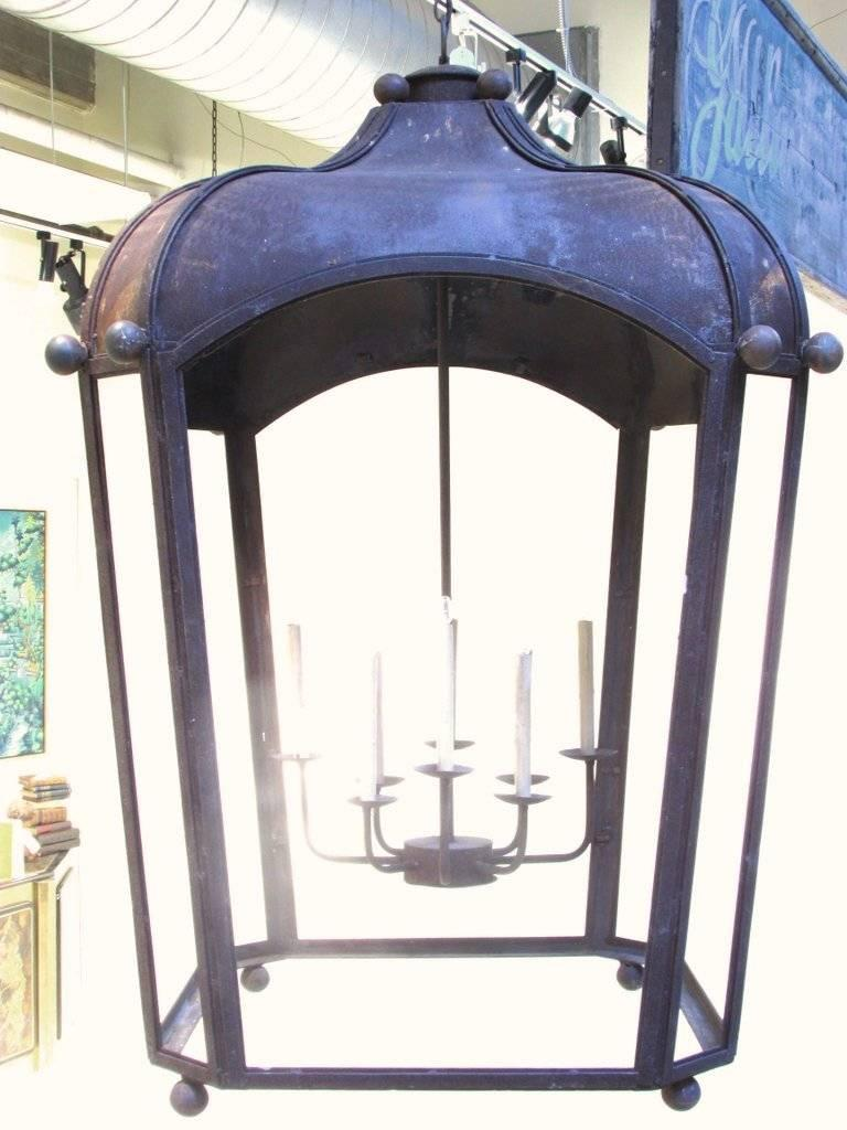 Custom made huge commanding lantern style chandelier with 8 light sockets with overall rusty finish has 6 foot chain