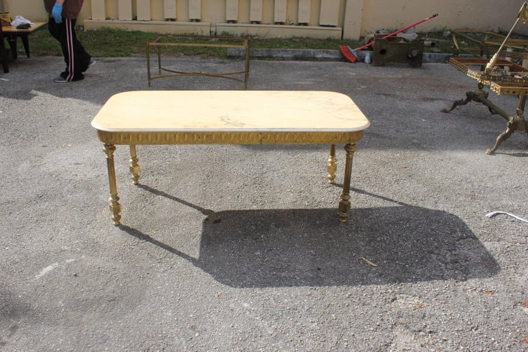 Monumental French neoclassical coffee or cocktail table bronze rectangular with beige color onyx top, circa 1940s. Size 47.50 W x 24 D x 19.50 H.