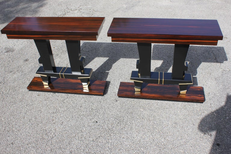 Pair of French Art Deco exotic Macassar ebony console tables, circa 1940s.