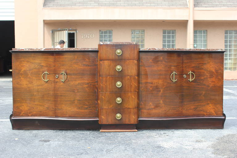 Monumental French Art Deco sideboard or buffet Macassar ebony. With marble top elaborate hardware, beautiful curves. This is a stunning sideboard. Center line of drawers. (With the original finish in very good condition.)