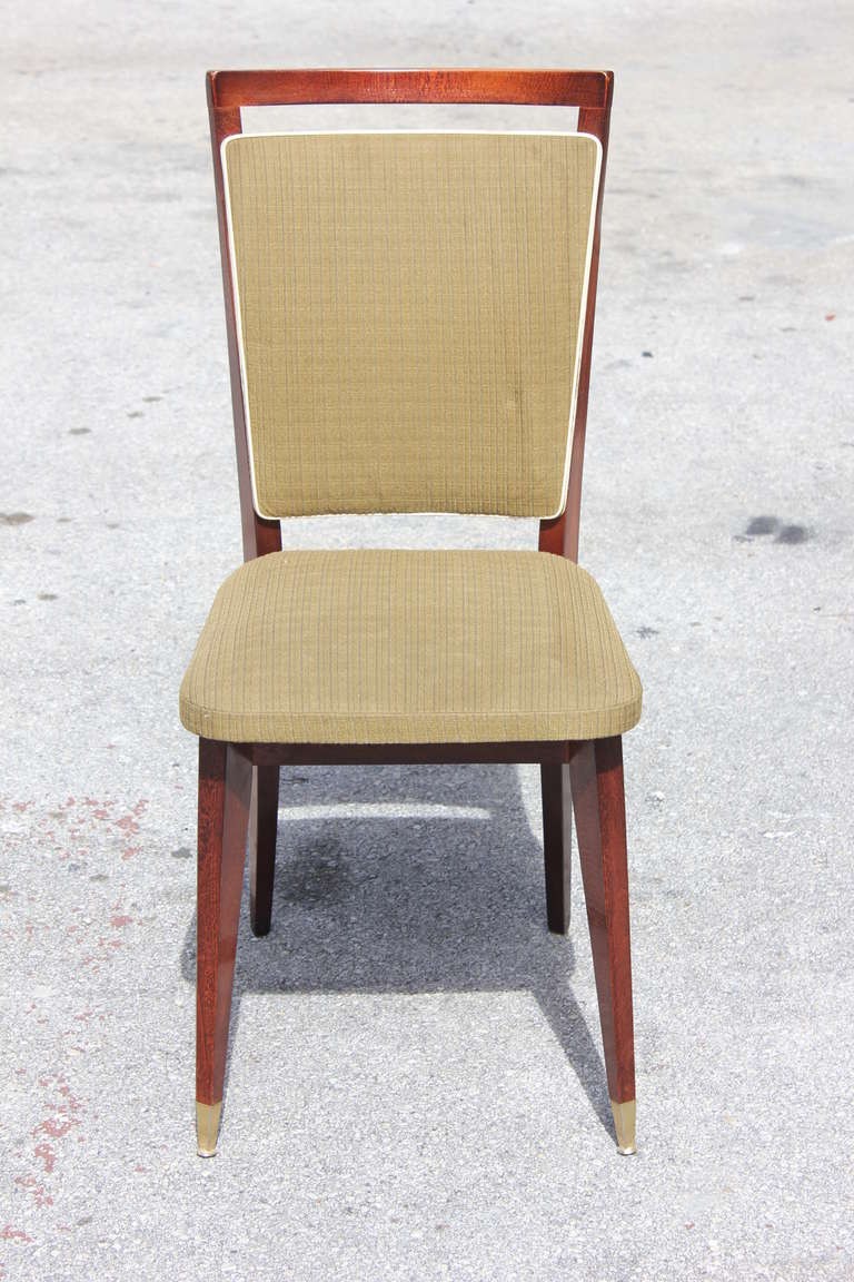 A set of six French Art Deco solid mahogany dining chairs. Reupholstery recommended to be change for all six dining chairs.